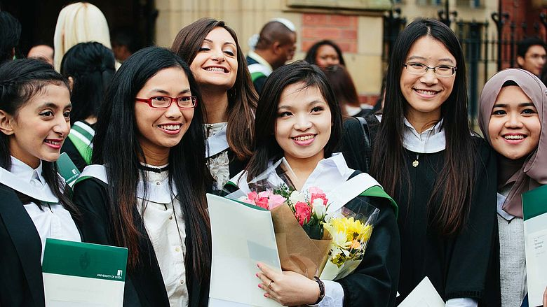 Six female graduates at their alumni graduation ceremony